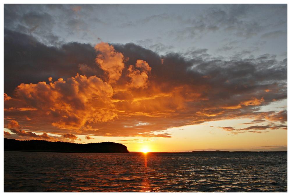 wolkenreicher Sonnenuntergang