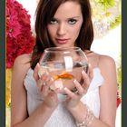 Woman Holding Fishbowl With Goldfish