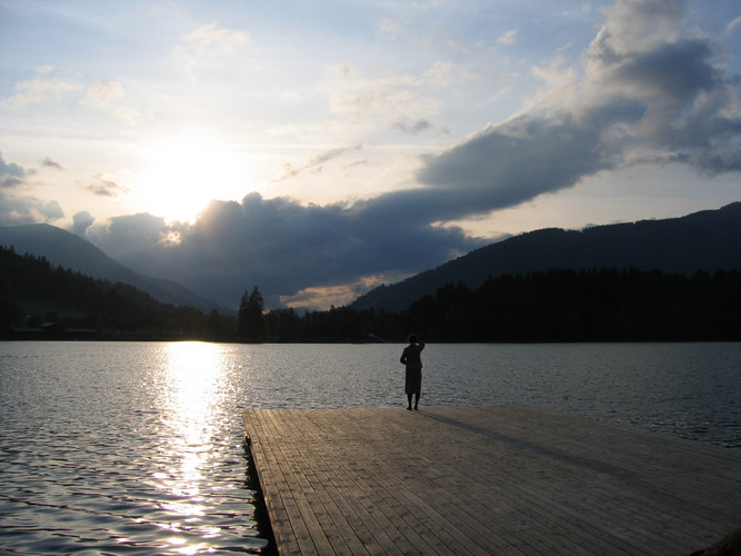 Woman standing at a lake in Tyrol