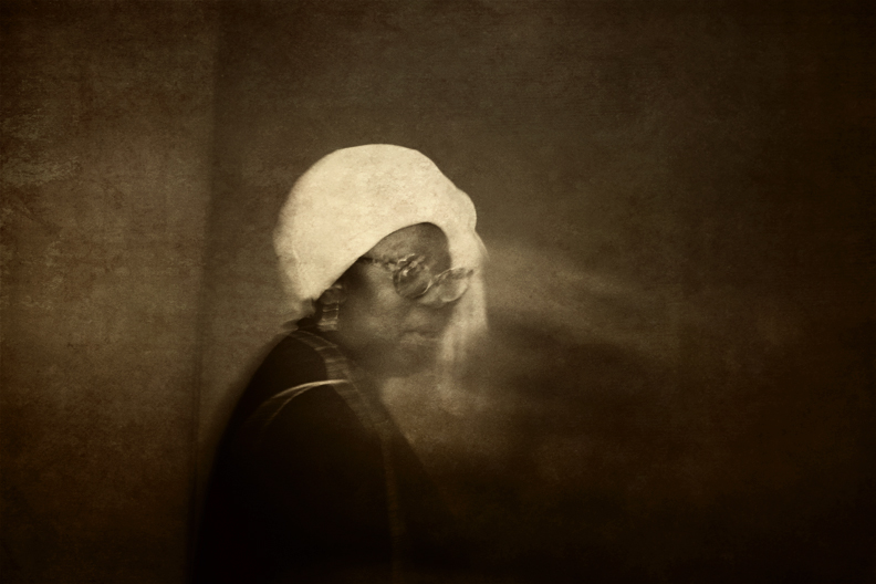 Woman with White Head Scarf