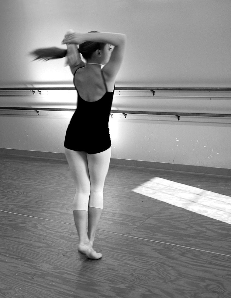 Young ballet dancer: turn
